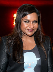 Mindy Kaling sported a long side-parted hairstyle at the Opening Ceremony Spring 2015 show.