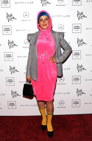 Alia Shawkat finished off her dress with a micro-houndstooth blazer.