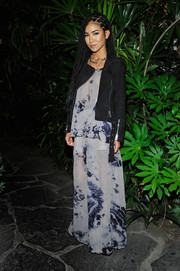 Jhene Aiko attended the #mycalvins Denim Series launch wearing a black suede moto jacket over a tie-dye blouse.