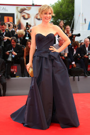 Radha Mitchell glammed it up at the Venice Film Festival opening ceremony in a strapless navy ball gown by Marchesa.