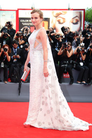 Diane Kruger looked very queenly on the Venice Film Festival red carpet in a beaded silver Prada gown with a flowing cape.