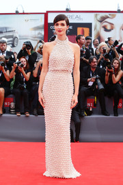Paz Vega looked supremely sophisticated in a pearl-studded gray halter gown by Ralph & Russo Couture at the Venice Film Festival opening ceremony.