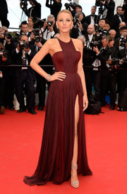 Blake Lively attended the 'Grace of Monaco' premiere looking like a goddess in a burgundy Gucci Premiere gown featuring a geometric neckline and a thigh-high slit.