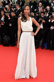 Zoe Saldana was ultra girly at the 'Grace of Monaco' premiere in a sleeveless white Victoria Beckham gown featuring a pleated skirt and ruffle detail on the bodice.