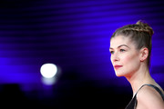 Rosamund Pike went for boho glamour with this braided updo at the Rome Film Fest premiere of 'Hostiles.'