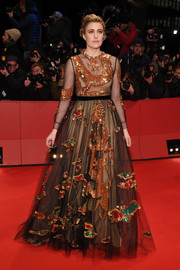 Greta Gerwig looked regal in a sequin-embellished tulle ball gown by Valentino at the Berlinale opening ceremony.