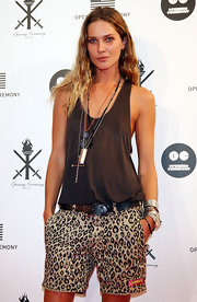 Erin paired her casual tank top with leopard print shorts and layered of pendant necklaces.