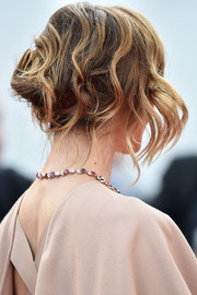 Clotilde Courau looked romantic wearing this loose bun with wavy tendrils at the Cannes Film Festival premiere of 'La Tete Haute.'