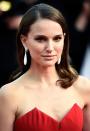 Natalie Portman styled her hair with a sleek side part and wavy ends for the Cannes Film Festival opening ceremony.