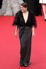 Julianne Moore looked downright regal in a beaded and feathered gown by Armani Prive during the Cannes Film Festival opening ceremony.