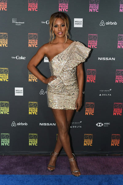 Laverne Cox turned heads in a gold one-shoulder mini dress by Alexandre Vauthier at the WorldPride NYC 2019 opening ceremony.