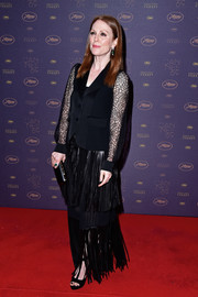 Julianne Moore teamed her jacket with a fringed leather maxi skirt.