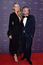 Blake Lively was dressed to impress in a feathered evening coat by Salvatore Ferragamo at the Cannes opening gala dinner.