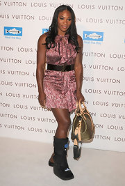 Serena cinched her ruffle dress with a sleek metallic belt and gold emblem.