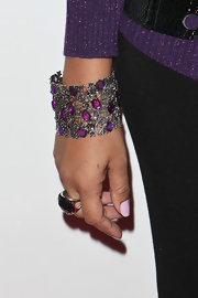 Nadia highlighted her purple sweater with a matching gemstone encrusted cuff.
