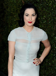 Dita Von Teese styled her hair in soft waves that conjured Old Hollywood glamour.