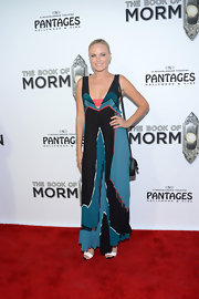 Malin donned a pleated color-block dress with sheer insets to the opening night of 'The Book of Mormon.'