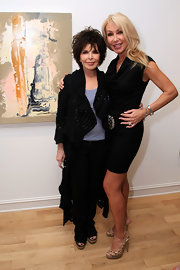 Linda Thompson's cowlneck LBD struck the perfect balance of sexy and sophisticated.