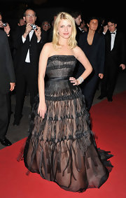 Melanie wore a dramatic black organza ball gown with a nude underlay and cinched waist for the Cannes red carpet.