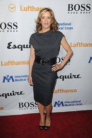 A gray cocktail dress with a thick belt showed off Felicity Huffman's curves on the red carpet of the opening night of the Esquire House in LA.