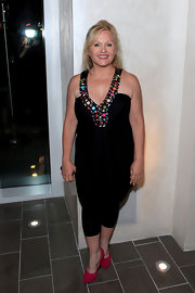 Charlene Tilton looked chic in a halter jumpsuit with cute colorful beads.