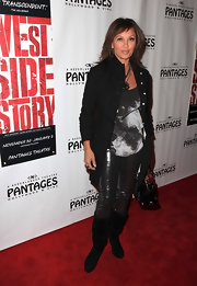 "Vanessa Williams looked casual at the premiere of ""West Side Story"" in slouchy mid-calf boots. She paired the black suede boots with metallic pants and a newly feathered hairstyle."
