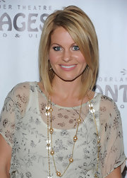 Candace Cameron Bure wore her hair in a cute layered bob with long side-swept bangs at the opening night performance of 'Wicked.'