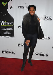 Regina King attended the opening of 'Wicked' wearing killer gray thigh-high boots.