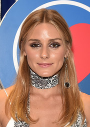 Olivia Palermo topped off her look with a single dangling earring by MAX&Co.