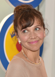 Maggie Gyllenhaal went old school with this messy high bun and wavy bangs for the opening party of LOVE: From Cave to Keyboard.
