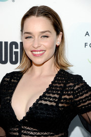 Emilia Clarke went for a casual flip when she attended the REFUGEE exhibit opening.
