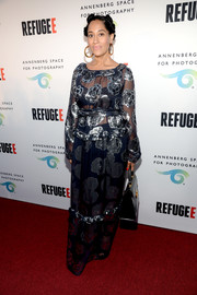 Tracee Ellis Ross went for boho glamour in a floral maxi dress by Suno during the REFUGEE exhibit opening.