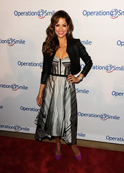 Brooke Burke gave her evening gown femme fatale appeal by layering on a leather moto jacket.