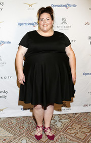 Chrissy Metz added a pop of color with a pair of fuchsia lace-up flats.