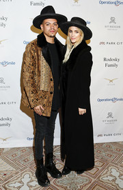 Ashlee Simpson was goth-glam in a long black coat with fur lapels during Operation Smile's Celebrity Ski & Smile Challenge.