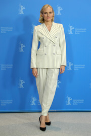 Diane Kruger opted for a white pinstriped pantsuit by Alessandra Rich when she attended the Berlinale photocall for 'The Operative.'