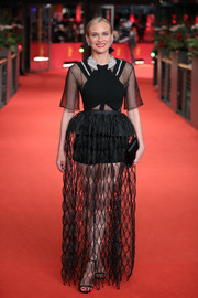 Diane Kruger showed some skin in a partially sheer black gown by Givenchy Couture at the Berlinale premiere of 'The Operative.'