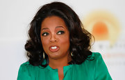 Oprah Winfrey sported soft, bouncy curls during a visit to her Leadership Academy for Girls.
