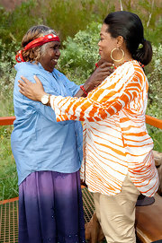 Oprah Winfrey visited Uluru, Australia wearing an orange and white zebra-print blouse.