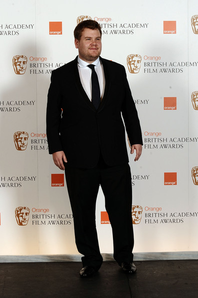 James paired his patent leather shoes with a black suit and matching tie.