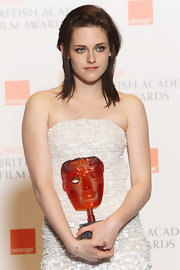 "The ""Twilight"" star sported a messy, layered, shoulder-length hairstyle."