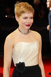 Michelle Williams wore her hair in an adorable slightly mussed pixie cut at the 2012 Orange British Academy Film Awards.