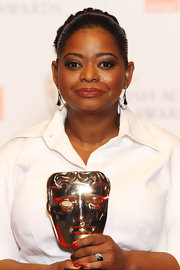 Octavia Spencer wore a stunning pair of black and white diamond kite earrings at the 2012 BAFTA Awards.