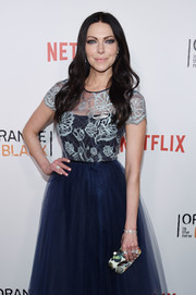 Laura Prepon attended the New York premiere of 'Orange is the New Black' carrying a lovely butterfly-print clutch.