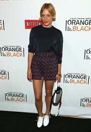Chloe Sevigny opted for a dark look with a midnight blue sweater, which she paired with a pair of printed shorts.