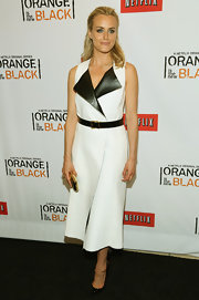 Taylor Schilling opted for a sleek and contemporary look at the 'Orange is the New Black' premiere where she wore this white sleeveless frock with leather lapels.