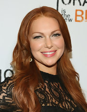 Laura added a slight wave to her fiery red hair for an instant red carpet ready look.