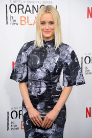 Taylor Schilling matched her nail polish to her gray dress when she attended the 'Orange is the New Black' season 2 premiere.