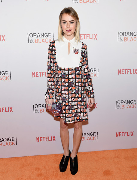 Taryn Manning looked preppy in a badge-print shift during the Orangecon fan event.