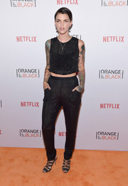 'Orange Is the New Black' star Ruby Rose wears a Fleur Du Mal sequin embellished crop top and matching harem pants at the Orangecon fan event in New York City.